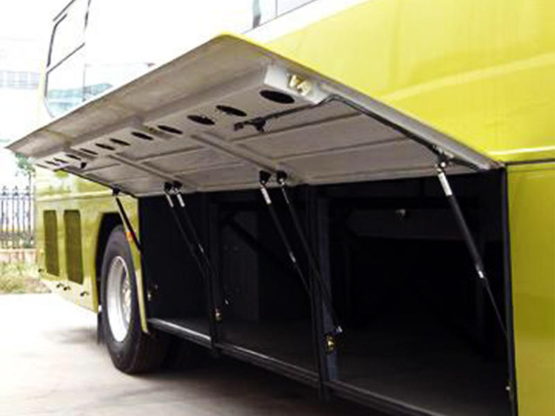 Gas spring for bus luggage lid opening